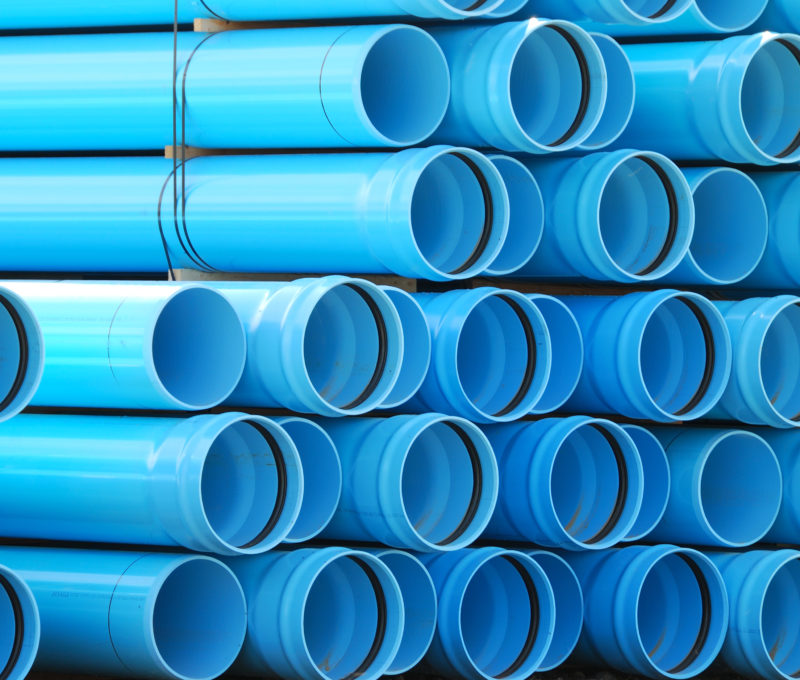 Large stack of water pipes ready to be used in an irrigation project near Oregon