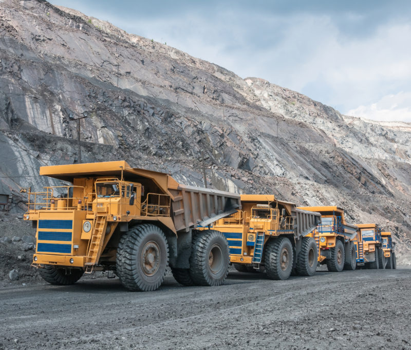 Fleet of yellow trucks on a mine site